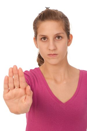 Attractive teenage girl gesturing stop sign Stock Photo - 13077970