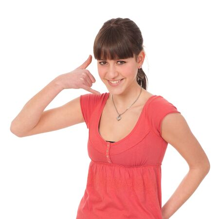 Beauty portrait of a cute girl gesturing a phone call - call me isolated over white background Stock Photo - 13077953