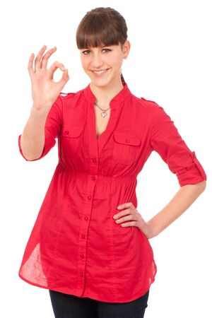 Smiling woman showing okay sign isolated over a white background Stock Photo - 13077965