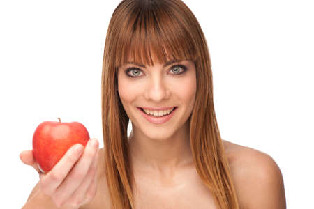 Healthy lyfestyle concept - attractive brunette girl with an apple in her hand Stock Photo - 13232452