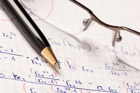 Mathematics formula written on a paper with a pen Reklamní fotografie