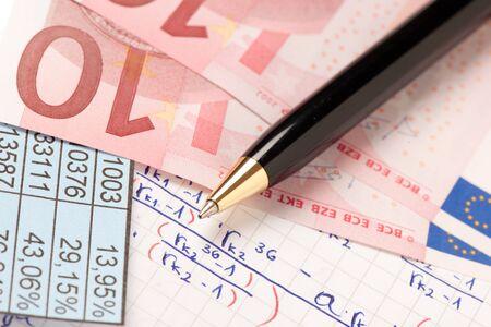 Mathematics formula written on a paper with a pen