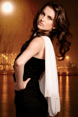 Beautiful young woman with white scarf in industrial port environment at dusk  Stock Photo - 14655728
