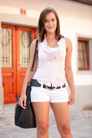 Urban lyfe - cute girl with a bag on a street photo