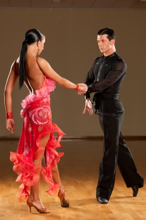 latino dance couple in action photo