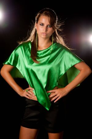 young beautiful woman in green dress, studio shot with lights in background Stock Photo - 15288732