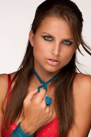 Beautiful young model in red underwear with jewelery Stock Photo - 15288784