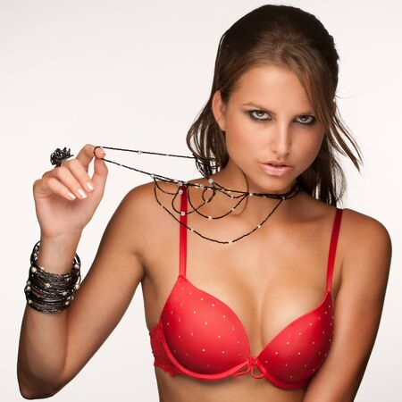 Beautiful young model in red underwear with jewelery Stock Photo - 15288703