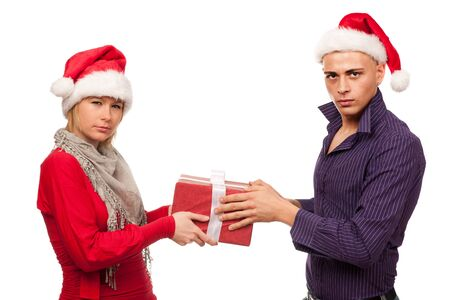 Girl and man with santa hat fighting for a present Stock Photo - 16119069