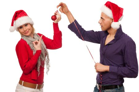 Christmas gift - Girl in santa dress giving a gift to a man Stock Photo - 16119076