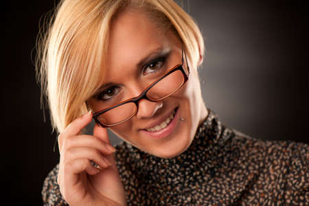 Beautiful young blonde with eyeglasses isolated  photo