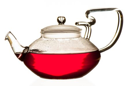 forest tea: Fruits of the forest tea in glass teapot isolated over white background