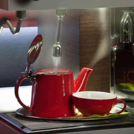 coffee pot: Bar - preparing tea in a tea pot