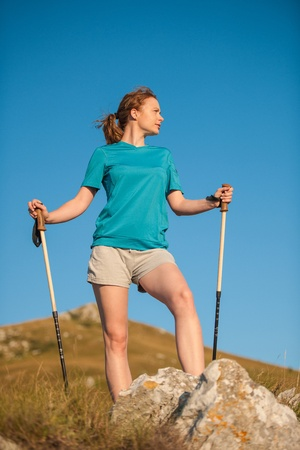 Girl hiking on mountains photo