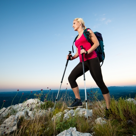 woman hiking: Woman on trekking - Beautiful blonde girl hiking on mountains