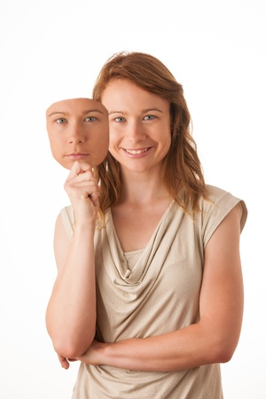 Woman hiding under the happy mask. Hypocritical, insincere, two-faced female photo