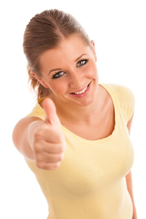 Beautiful young woman with blue eyes showing thumb up Stock Photo - 21852982
