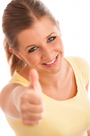Beautiful young woman with blue eyes showing thumb up Stock Photo - 21852983