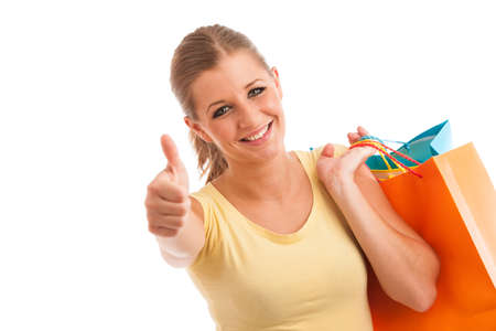 attractive young woman with vibrant shopping bags isolated over white background photo