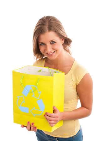 Young woman holding recycle paper bag. photo