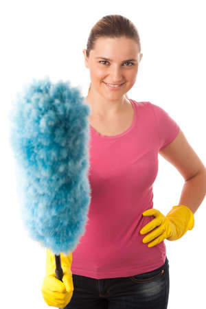 Young happy woman cleaning dust isolated over white background Stock Photo - 21962495