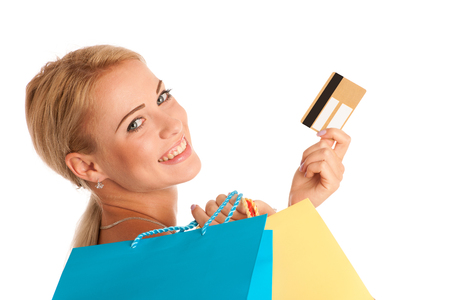 Attractive blonde girl with colorful shopping bags isolated over white background photo