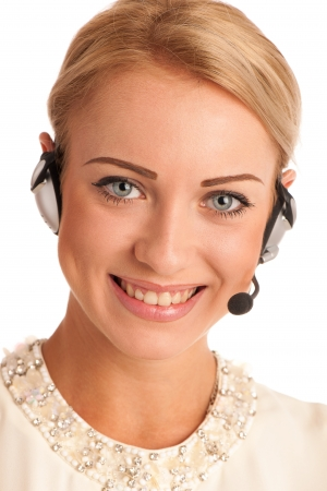 Beautiful young business woman with headset isolated over white background photo