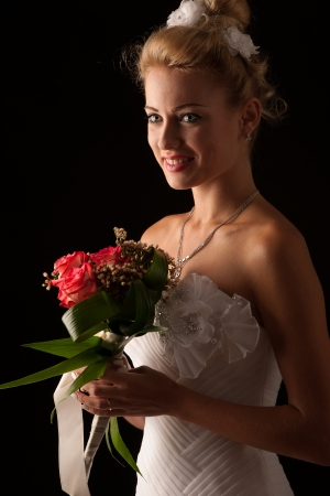 Beautiful bride isolated over black background