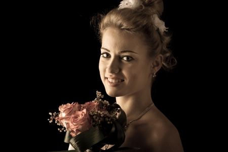 wedding gawn: Beautiful bride isolated over black background