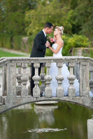 Bride and groom in a park outdoor - Married couple photo