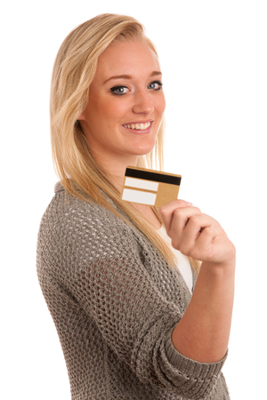 Young woman with golden credit isolated over white Stock Photo - 22603389