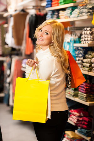 Beautiful youing woman in shopping photo