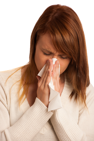 Woman with flu sneezing photo