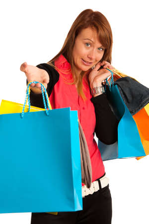 Attractive young woman in shopping isolated over white photo