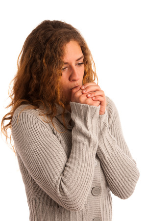 shiver: Woman blowing in her hands when feeling cold isolated Stock Photo