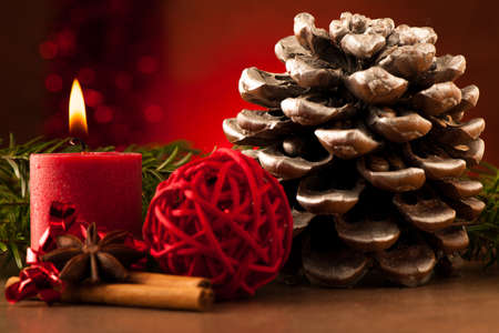Pine cone and candle cristmas decoration photo
