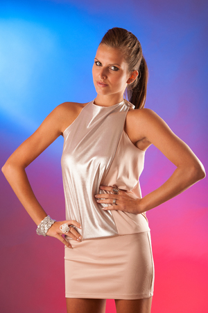 Party lady - beautiful woman over colorful background photo