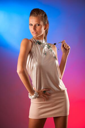 Party lady - beautiful woman over colorful background Stock Photo - 23160984