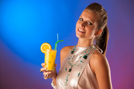 Cute young woman with cocktail photo