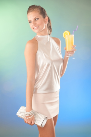 Cute young woman with cocktail Stock Photo - 23160996