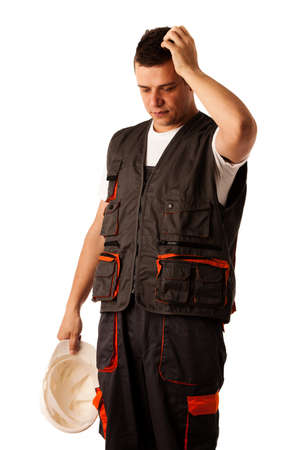 Worried construction worker isolated over white background photo