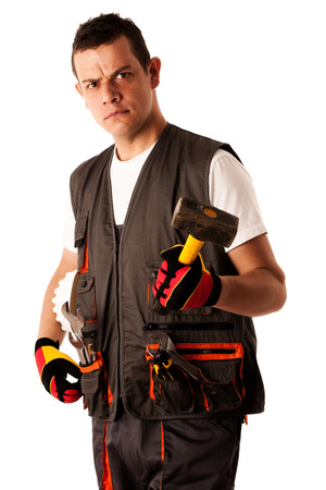 Construction worker in work dress isolated over white background photo