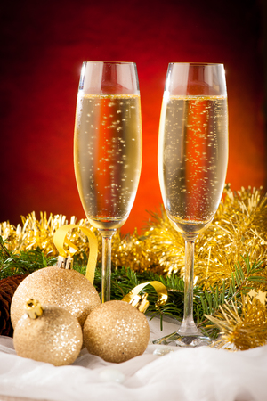 Two glasses of sparkling wine on christmas and new year decoration arrangement background photo