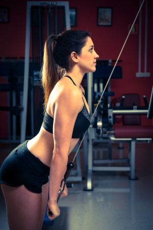 Woman working out in fitness - Active girl photo