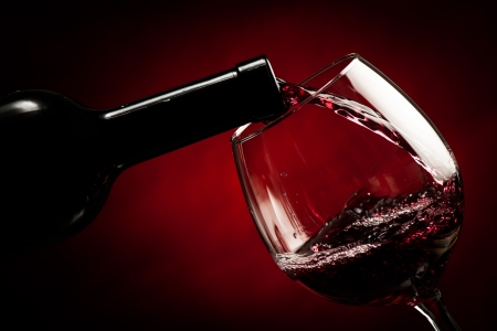 Bottle filling the glass of wine - splash of delicious flavor