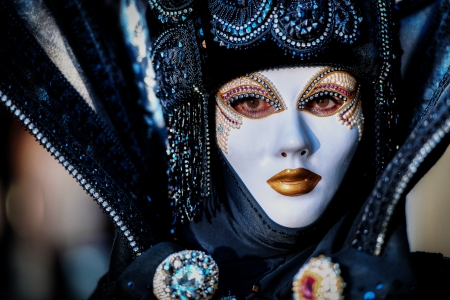 VENICE, ITALY - FEBRUARY 8: Unidentified person in Venetian masks at St. Marks Square, Carnival of Venice on February 8, 2013. The annual carnival is from February 2 to February 12, 2013.