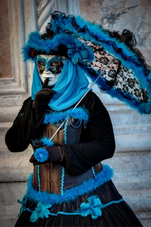 VENICE, ITALY - FEBRUARY 8: Unidentified person in Venetian masks at St. Mark's Square, Carnival of Venice on February 8, 2013. The annual carnival is from February 2 to February 12, 2013.