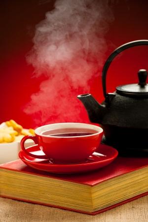 housewares: Teapot and tea cup arangement on a table