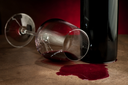 alcohol bottles: Spillde wine after party Stock Photo