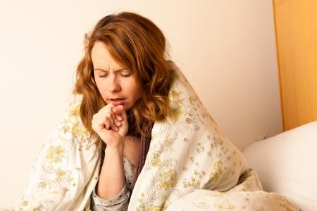Woman cough Standard-Bild
